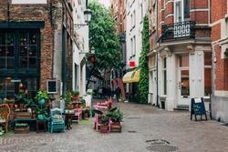 Old street with flower shop in historic city center of Antwerpen (Antwerp), Belgium. Cozy cityscape of Antwerp. Architecture and landmark of Antwerpen