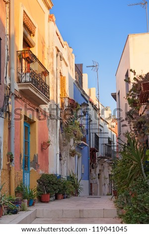 Old street with multicolored houses in ancient spanish town