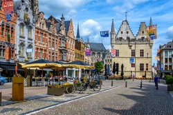 Old street with tables of cafe in Mechelen, Belgium. Mechelen is a city and municipality in the province of Antwerp, Flanders, Belgium.