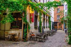 Old street with tables of restaurant in Antwerpen (Antwerp), Belgium. Cozy cityscape in Antwerp