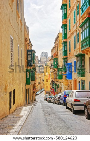 Old street with traditional houses at the city center of Valletta, Malta #580124620