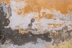 Old stucco wall. Grey and yellow.