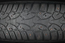Old studded tire, can be used as background
