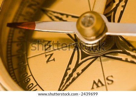Old style brass compass close up