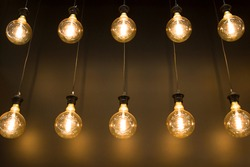 Old style bulb light hanging from ceiling, vintage indoor lamps. Light bulbs in retro style.