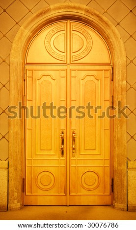 Old style closed wooden door in a church - stock photo