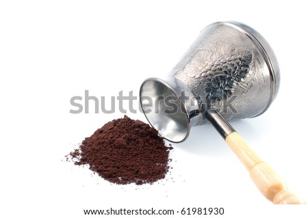 Old style coffee pot and ground coffee, isolated on white background