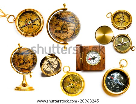 Old style compasses and globes isolated on white background