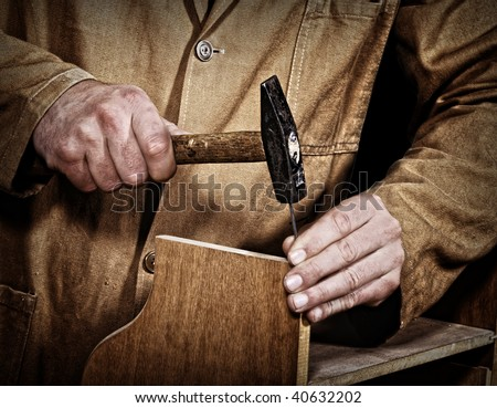 old style craftsman at work fine closeup detail background