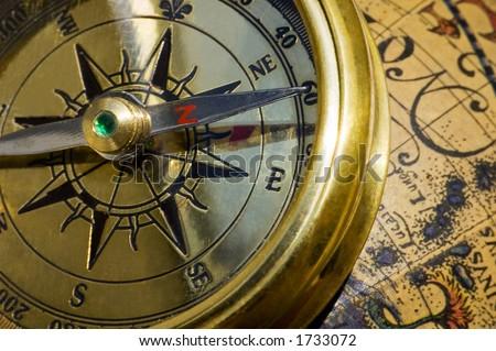 Old style gold compass & globe closeup - stock photo