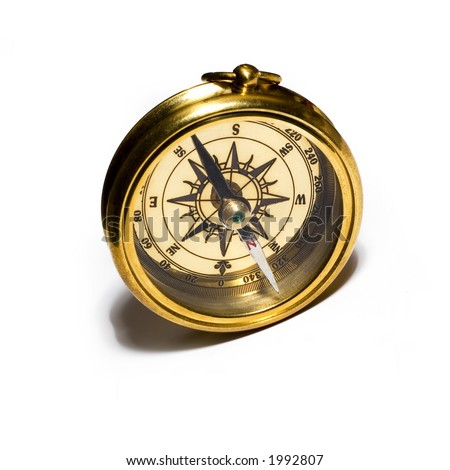 Old style gold compass on white background - stock photo