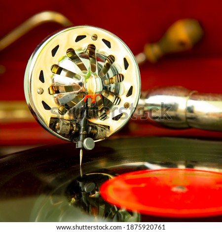 Old style gramophone, retro records player close-up photo. Selective focus on a needle. Stock fotó ©
