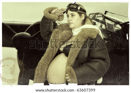 Old style image of a pregnant woman with pilot jacket and a bomber as background