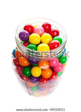 Old style jar packed with colorful gumballs