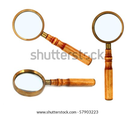 Old style magnifying glass isolated on white