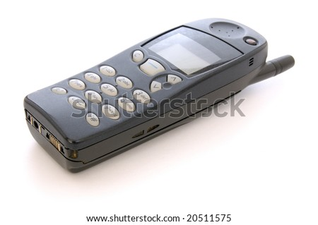 old style mobile phone cellphone handset on white background