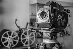 Old style movie projector, still-life, close-up. retro vintage tape video camera. antique film projector