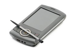 Old style PDA smartphone on isolated white background.