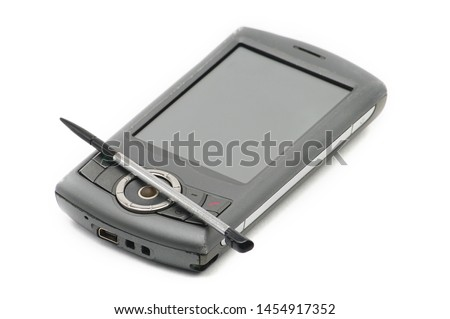Old style PDA smartphone on isolated white background. Stock fotó ©