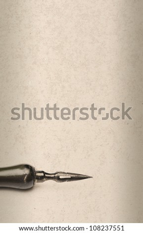 old style pen on grunge background