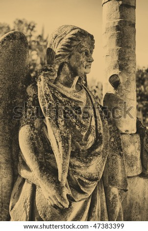 stock photo : old style photo of angel statue in cemetery