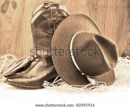 old style picture of cowboy boots and hat