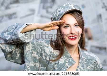 Old style portrait of an enthusiastic brunette army pin-up girl wearing uniform saluting for enrollment at a new recruit office