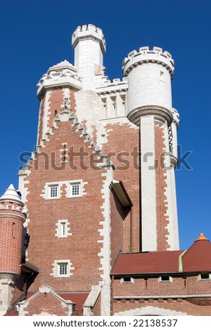 old style red brick castle in sunset light