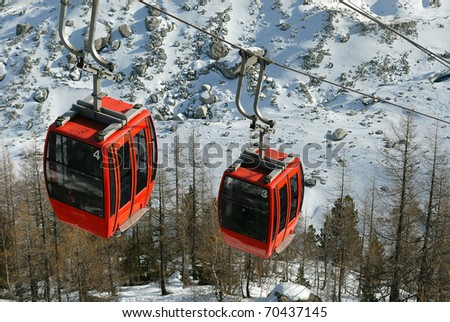 Old style small cable cars in French Alps
