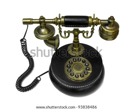 Old style telephone made of brass and leather isolated on white