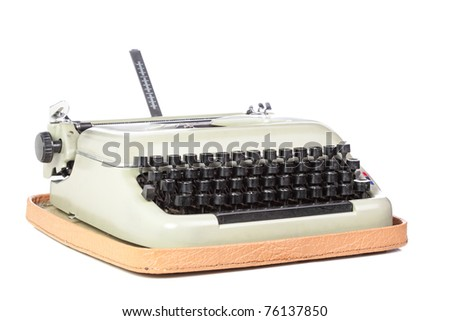 old style typing machine against white background