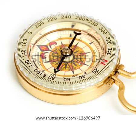 old styled, gold compass isolated on white background