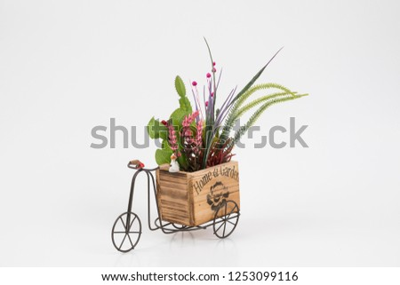 Old styled tricycle decorative decorative floral ornamental wonderful background stands on white background. #1253099116
