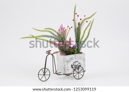 Old styled tricycle decorative decorative floral ornamental wonderful background stands on white background. #1253099119