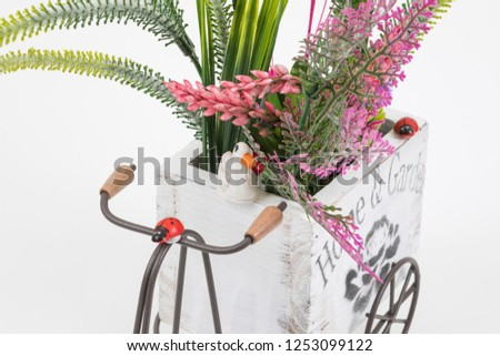 Old styled tricycle decorative decorative floral ornamental wonderful background stands on white background. #1253099122