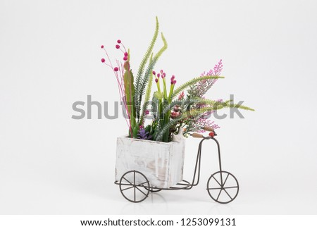Old styled tricycle decorative decorative floral ornamental wonderful background stands on white background. #1253099131