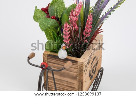 Old styled tricycle decorative decorative floral ornamental wonderful background stands on white background. #1253099137