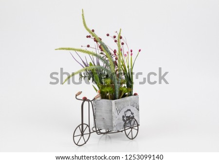 Old styled tricycle decorative decorative floral ornamental wonderful background stands on white background. #1253099140