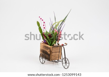 Old styled tricycle decorative decorative floral ornamental wonderful background stands on white background. #1253099143