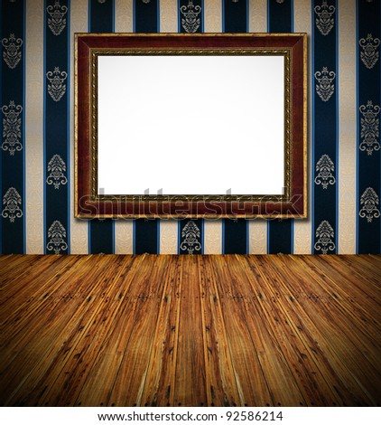 old stylish vintage golden frame on dark blue rich  textile decorated wall background and wooden massive rough planks floor foreground interior