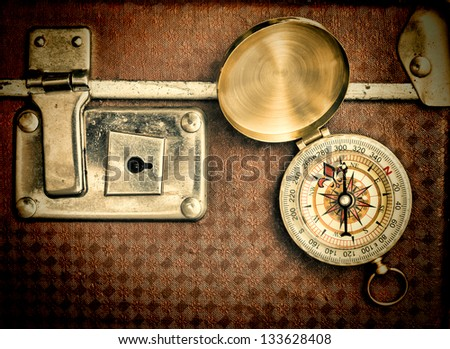 old suitcase  and compass  isolated on white background