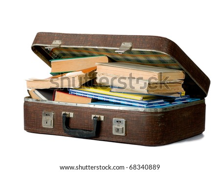 Old suitcase filled with old books