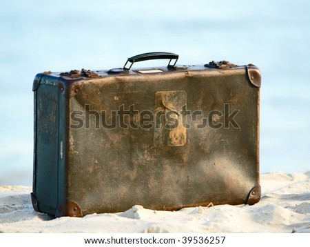 Old suitcase on the beach