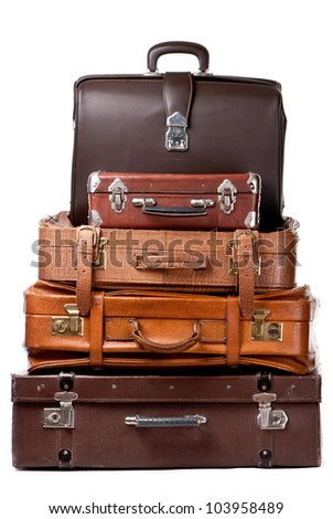 Old suitcases isolated on a white background