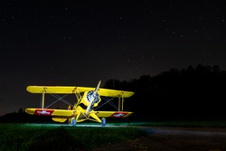 old Swiss air force biplane warbird photographed under a beautiful nightsky with stars