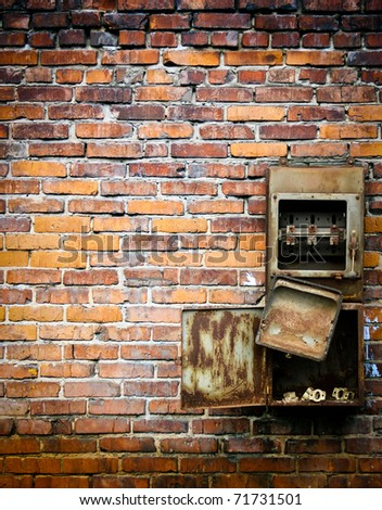 old switch on a brick wall