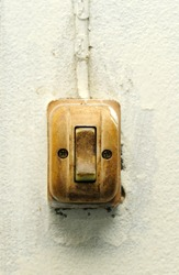 Old switch on white wall