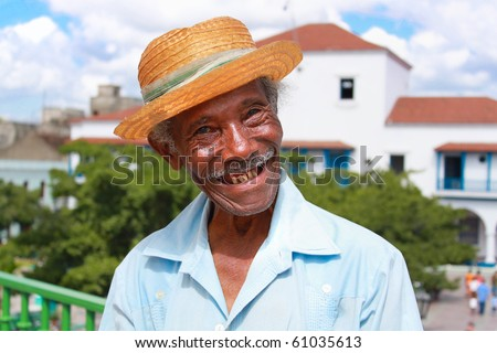 Old sympathetic cuban man with straw hat make a funny face, Santiago de Cuba, Cuba