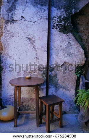 Old table and old wall #676284508