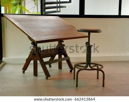 Old tables and old chairs for writing. #662413864